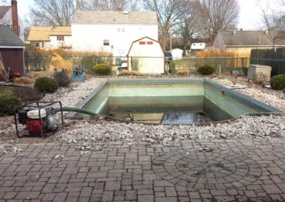 Pool Renovations - pumping out pool 2